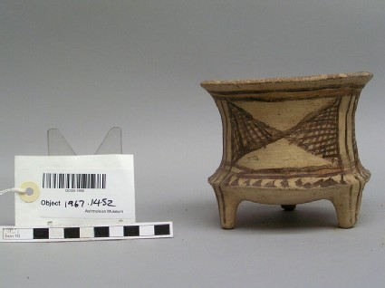 Tripod jar with dark painted decoration