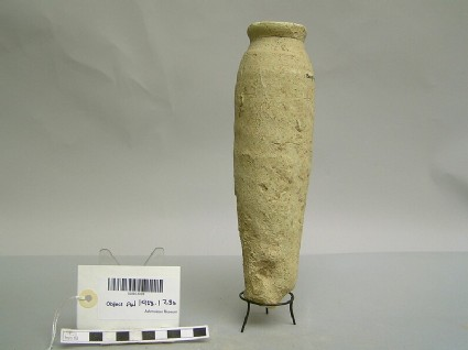 Bottle made of baked clay with a rounded base