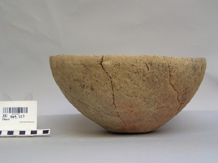 Cracked large baked clay bowl