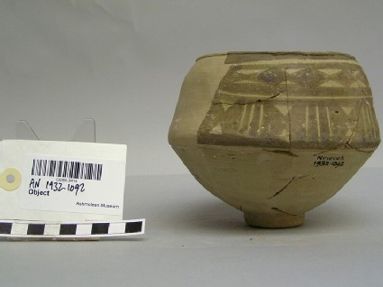 Pot with brown geometric pattern
