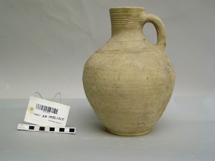 Baked clay jar with a handle and incised rings