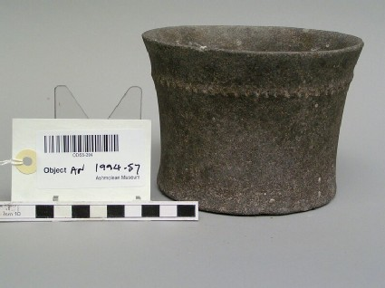 Bowl with band of notched decoration round the outside below rim