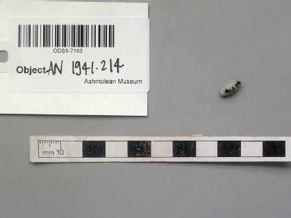 Pale green faience bead, barrel-shaped