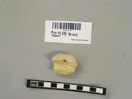 Bone pommel fragment with hole