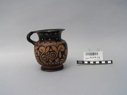 Red-figure mug decorated with floral design and cat