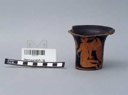 Fragment of Apulian vase with Eros kneeling, woman with a box