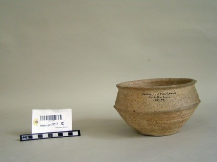 Carinated buff-ware bowl with wide mouth and down-turned rim