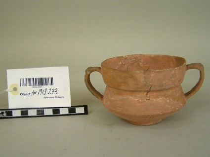Two-handled cup of fine thin grey ware