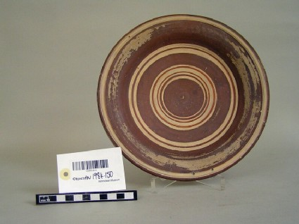 Plate decorated with concentric painted bands