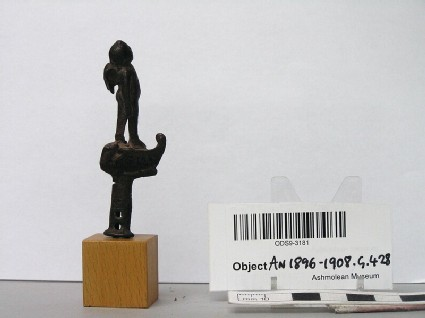 Bronze winged figure standing on boat prow
