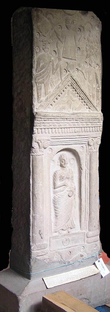 Neopunic relief of female standing in niche below deities and animals