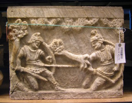 Etruscan urn with combat in landscape