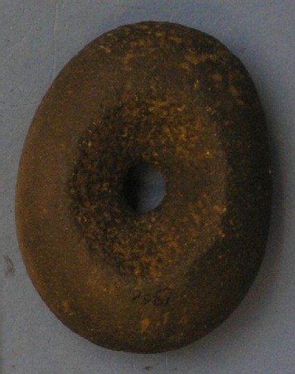 Pebble hammer with central perforation