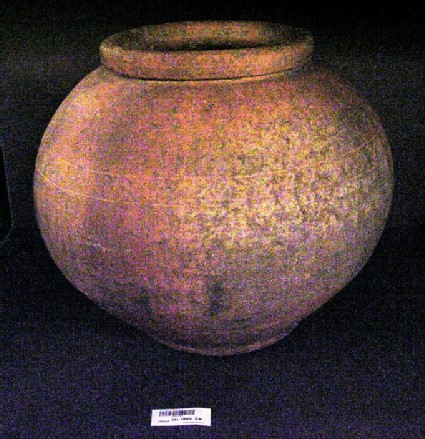 Pink grogged ware storage jar made in Stowe Park, repaired with lead plug and reused for burial about AD 300