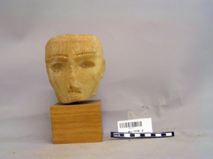 Alabaster head and wooden stand