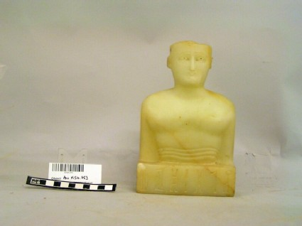 Calcite-alabaster funerary bust of a man with inscription in a South Arabian script