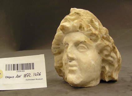 Sculpture, head of small statue with Phrygian cap