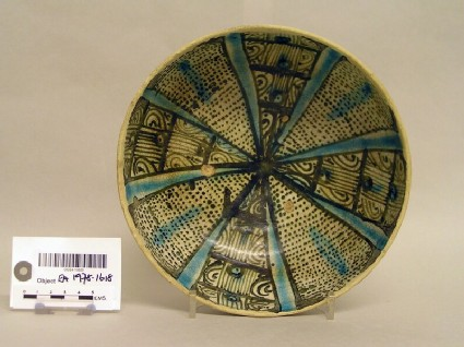 Bowl with panelling and abstract motifs