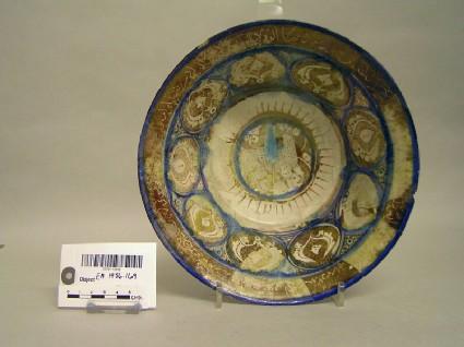 Bowl with quadruped, palmettes and epigraphic decoration