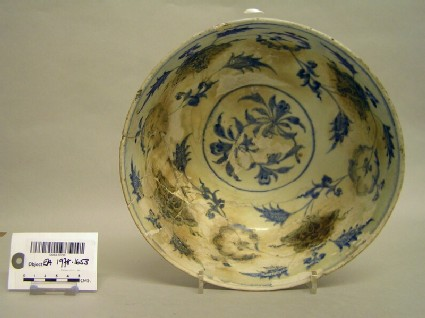 Bowl with flowers and vegetal sprays