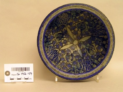 Bowl with four-petalled flower