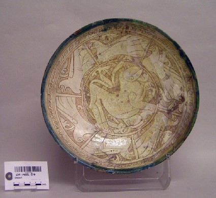 Bowl with quadruped and birds