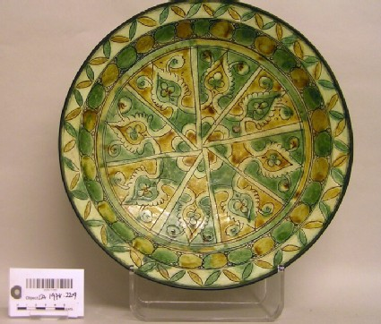 Dish with panels and leaf design