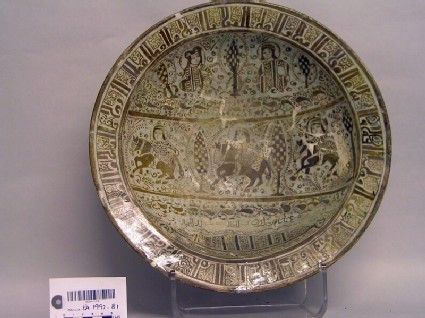 Dish with seated figures, horsemen, and inscription