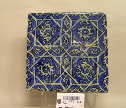 Tile with flowers and geometric motifs