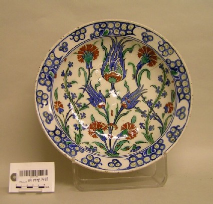 Dish with tulips and carnations