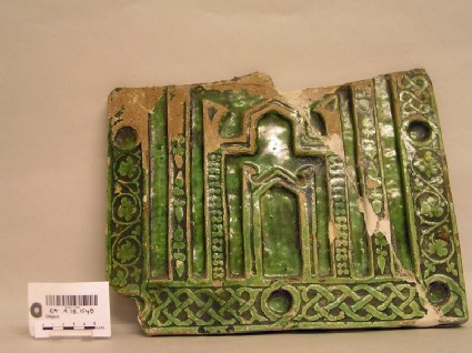 Fragmentary tile with architectural decoration and floral friezes