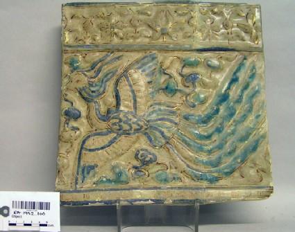 Tile with phoenix