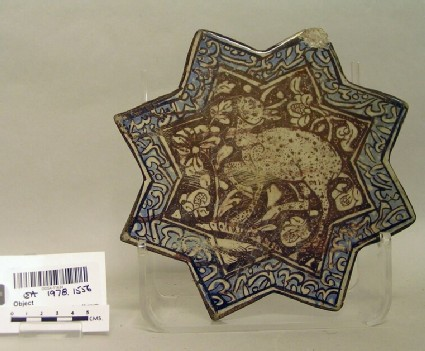 Star-shaped tile with antelope and inscription