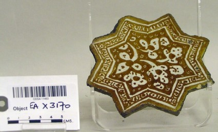 Star-shaped tile with floral decoration
