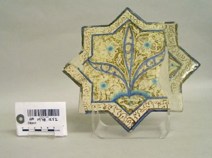 Star-shaped tile with leopards and inscription