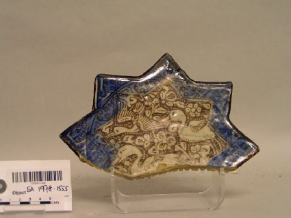 Fragment of a star-shaped tile with ducks and bird