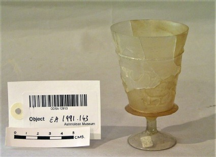 Glass beaker decorated with peacocks in relief