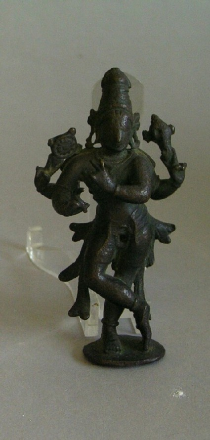 Four-armed fluting Krishna with conch and chakra