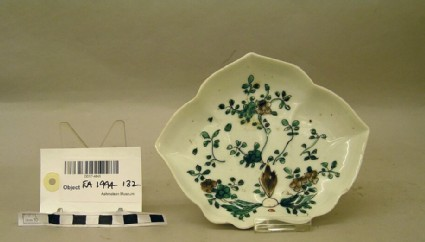 Leaf-shaped dish with flowers and scrolling foliage