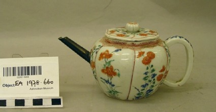 Teapot with poppies, chrysanthemums and lilies
