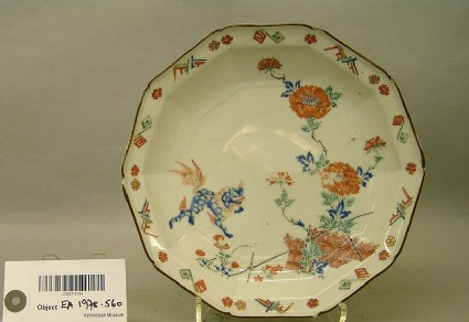 Plate with shishi lion dogs, plants and decorated border
