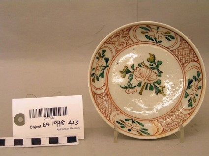 Dish with peony spray and geometrically patterned border