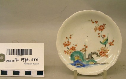 Saucer with a bird on prunus spray, with rocks and water