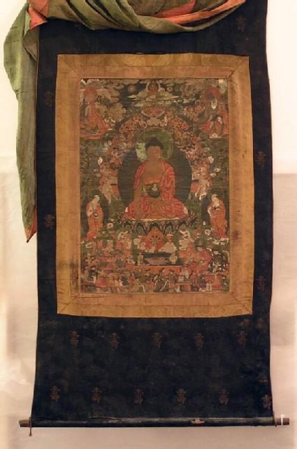 Buddha Shakyamuni surrounded by four figures