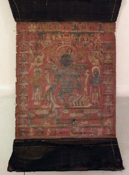 Thangka painting depicting seated Tara on throne with elephant and vyalas, with two standing attendants