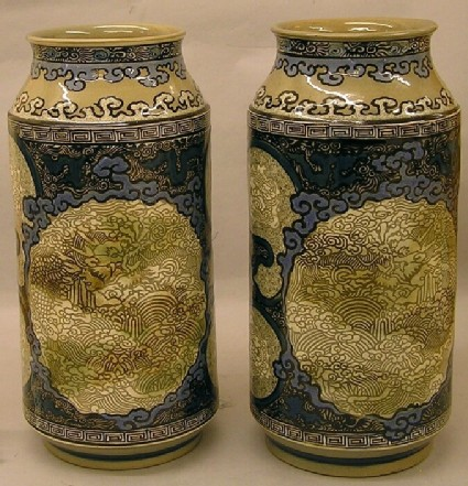Two albarelli vases with dragons in cartouches