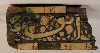 Wooden fragment inlaid with ivory
