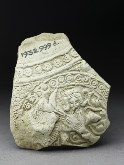 Fragment of a jug with human figure in a roundel