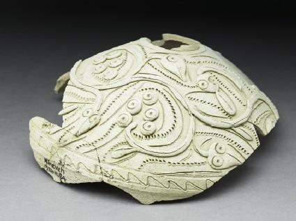 Fragment of a jug with vegetal decoration