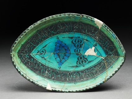 Dish with vegetal and calligraphic decoration